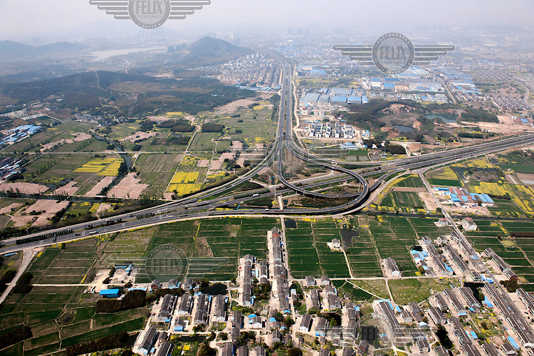 A complex road system and junction cuts through traditional fields and agricultural land. /Felix Features
