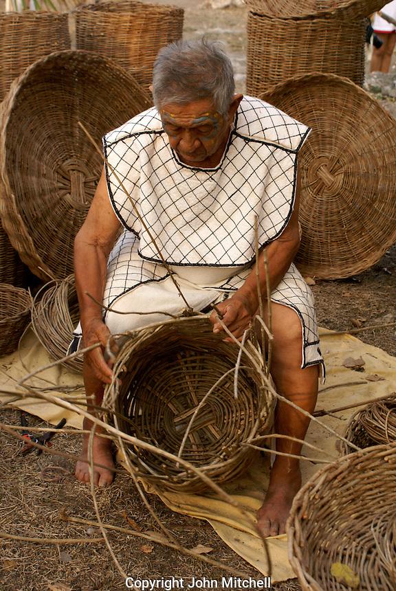 Maya basket maker at the recreation of an ancient Mayan market, Sacred Mayan Journey 2011 event, Riviera Maya, Quintana Roo, Mexico