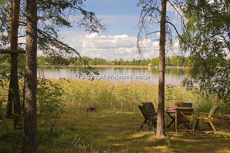 Inviting Afternoon Sun at Lakeside Cottage during Idyllic Finland Summer