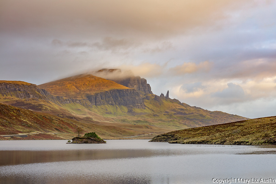 Isle of Skye, Scotland: Sunrise light and clouds over Loch Fada with the iconic Old Man of  Storr in the distance.