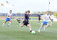 Rebecca Moros #19 of the Washington Freedom sends over a cross between Stephanie Cox #14 and Kristine Lilly #13 of the Boston Breakers during a WPS match on May 8 2010, at the Maryland Soccerplex, in Boyds, Maryland. The game ended in a 0-0 tie.