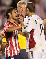 Chivas USA's Paulo Nagamura has a heated discussion with RSL's Yura Movsisyan. Real Salt Lake and Chivas USA played to a 2-2 draw in a MLS first round Western Conference playoff match. RSL advances on from aggregate total score at Home Depot Center stadium in Carson, California on Saturday November 8, 2008. Photo by Michael Janosz/isiphotos.com