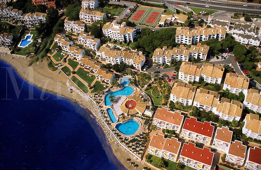 Spain. Costa del Sol.  Holiday apartments between Marbella and Malaga. Aerial..