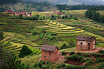 Terraced rice fields and mud houses in the central highlands of Madagascar.<br />