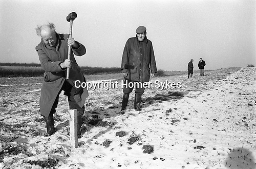 Laxton Jury Day and Court Leet. Laxton Nottinghamshire. England 1973. Staking out the strips of land. Annually November and first week of December.<br /> <br /> Laxton is the only place in England where the open-field system continues to be used.  It is thought that its anomalous survival is due to the inability of two early 19th century landowners to agree on how the land was to be enclosed, thus resulting in the perpetuation of the existing system.