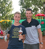 August 9, 2014, Netherlands, Rotterdam, TV Victoria, Tennis, National Junior Championships, NJK,  Prize giving, Richard Krajicek with Stijn Janssen, runner up  boys 12 years<br /> Photo: Tennisimages/Henk Koster