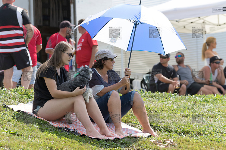 Some the many spectators enjoying the summer weather. Counties Manukau Premier Counties Power Club Rugby game between Karaka and Pukekohe, played at the Karaka Sports Park on Saturday March 10th 2018. Pukekohe won the game 31 - 27 after trailing 5 - 20 at halftime.<br /> Photo by Richard Spranger.
