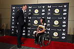 Ottawa, ON – Nov 27 2015 –Scott Russel and Chantal Petitclerc pose for a photo at the Canadian Paralympic Hall of Fame in Ottawa, Ontario Nov 27, 2015. Peticlerc was inducted into the Hall of Fame in the athlete category.  Photo Andre Forget / Canadian Paralympic Committee