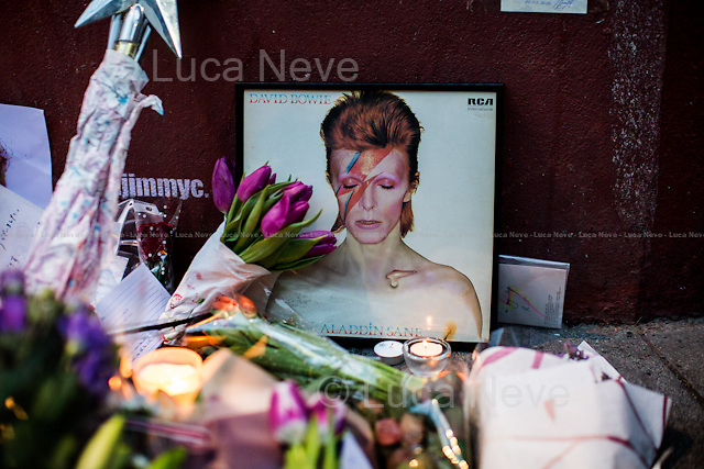 Brixton, Jimmy C Graffiti. <br /> <br /> London, 11/01/2016. Today, David Bowie has died at the age of 69. During the day London's people gathered in Brixton (At Jimmy C graffiti, outside the house at 40 Stansfield Road where he was born, and for the street party outside the Ritzy Cinema) and outside 23 Heddon Street (Where a plaque commemorates Ziggy Stardust) to leave a flower, a message, an album, a candle, a letter; tokens to remember and commemorate a Londoner, an icon and a legend of the world music. David Bowie, real name David Robert Jones (8 January 1947 &ndash; 10 January 2016), was born in Brixton. He was an English singer, songwriter, multi-instrumentalist, record producer, arranger, painter and actor. He died 18 months after being diagnosed with cancer. On the 8th of January, day of his 69th birthday, David Bowie released his 27th and last album: &quot;Blackstar&quot;.<br /> <br /> For more information please click here: http://www.davidbowie.com/