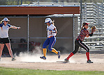 Wildcats' Bailey Henderson beats the throw to first in a game against Colorado Northwestern at Edmonds Sports Complex Carson City, Nev., on Friday, April 17, 2015.<br /> Photo by Cathleen Allison