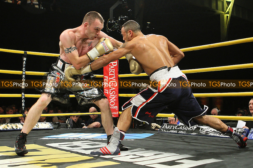Colin Lynes (silver shorts) defeats Young Mutley in the Semi-Final of Prizefighter 'The Light-Welterweights' at Olympia National Hall, London, promoted by Barry Hearn / Matchroom Sport - 04/12/09 - MANDATORY CREDIT: Gavin Ellis/TGSPHOTO - Self billing applies where appropriate - Tel: 0845 094 6026