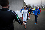 City's goalscorer Josh Walker moves to shake hands with the referee's assistant as the players make their way back to the dressing room at the end of the game.