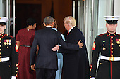 United States President Barack Obama (C) escorts President-elect Donald Trump and wife Melania into the White House for tea before the inauguration on January 20, 2017 in Washington, D.C.  Trump becomes the 45th President of the United States. <br /> Credit: Kevin Dietsch / Pool via CNP