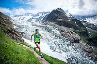 Trail running alongside glaciers above Grindelwald, Switzerland