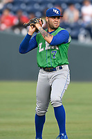 Third baseman Emmanuel Rivera (7) of the Lexington Legends warms up before a game against the Greenville Drive on Friday, June 30, 2017, at Fluor Field at the West End in Greenville, South Carolina. Lexington won, 17-7. (Tom Priddy/Four Seam Images)