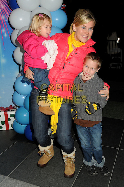"ALISON SWEENEY, daughter Megan and son Ben.Disney On Ice presents ""Let's Celebrate!"" held at L.A. LIVE, Los Angeles, California, USA..December 15th, 2010.full length carrying holding mother mom jeans denim boots tan mum kids children pink puffa jacket yellow scarf grey gray.CAP/ADM/BP.©Byron Purvis/AdMedia/Capital Pictures."