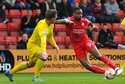 April 14th 2017, County Ground, Swindon, Wiltshire; Skybet league 1 football, Swindon Town versus AFC Wimbledon; Jon Obika, forward for Swindon Town takes on Dannie Bulman, midfielder of AFC Wimbledon