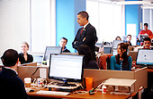 United States President Barack Obama gets some information from employees of OPOWER  before delivering remarks on clean energy jobs Friday, March 5 2010 in Arlington, Virginia..Credit: Olivier Douliery / Pool via CNP