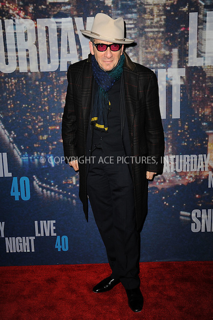 WWW.ACEPIXS.COM<br /> February 15, 2015 New York City<br /> <br /> Elvis Costello walking the red carpet at the SNL 40th Anniversary Special at 30 Rockefeller Plaza on February 15, 2015 in New York City.<br /> <br /> Please byline: Kristin Callahan/AcePictures<br /> <br /> ACEPIXS.COM<br /> <br /> Tel: (646) 769 0430<br /> e-mail: info@acepixs.com<br /> web: http://www.acepixs.com