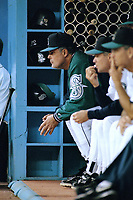 SEATTLE, WA:  Seattle Mariners manager Lou Piniella sits in the dugout during a game against the Oakland Athletics at the Kingdome in Seattle, Washington in 1996. (Photo by Brad Mangin)