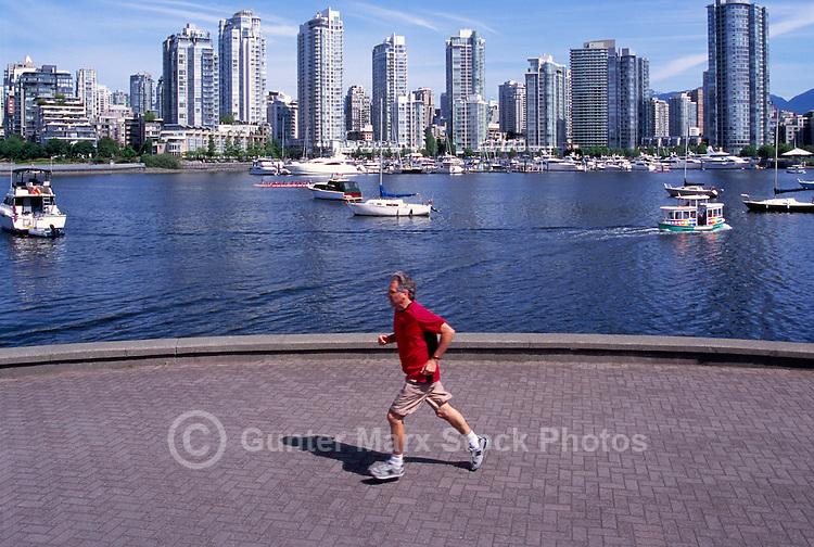 Vancouver, BC, British Columbia, Canada - City Skyline at False Creek and Yaletown, Man jogging on Seawall, Aquabus Ferry Public Transportation, Summer