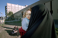 "(February 1998)    A girl and her mother outside t the Saddam hospital in Baghdad.    <br /> Due to UN sanctions the hospital was lacking many medicines, and the civilians suffered due to lack of food as well. <br />  Former U.N. Humanitarian Coordinator in Iraq Denis Halliday estimated the resulting deaths : ""Two hundred thirty-nine thousand children 5 years old and under"" as of 1998.<br /> <br /> The sanctions against Iraq were a near-total financial and trade embargo imposed by the United Nations Security Council on the Iraqi Republic.<br /> <br /> <br /> ©Fredrik Naumann/Felix Features"