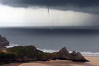 Pictured: A waterspout seen of Three Cliffs Bay in the Gower Peninsula near Swansea, south Wales. STOCK PICTURE<br />
