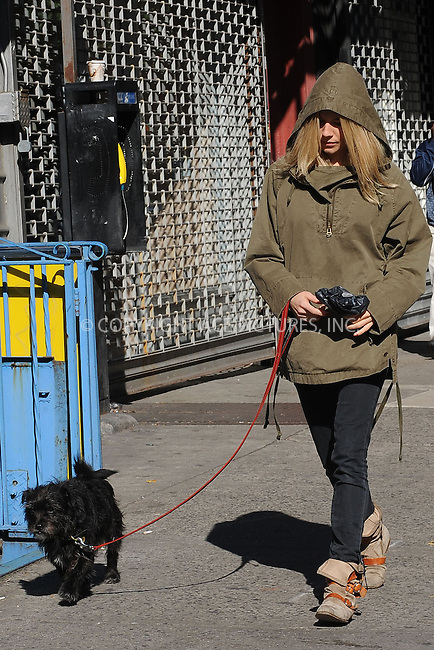 WWW.ACEPIXS.COM . . . . . ....November 4 2009, New York City....Actress Sienna Miller takes her dog for a walk around Soho on November 4 2009 in New York City....Please byline: KRISTIN CALLAHAN - ACEPIXS.COM.. . . . . . ..Ace Pictures, Inc:  ..tel: (212) 243 8787 or (646) 769 0430..e-mail: info@acepixs.com..web: http://www.acepixs.com