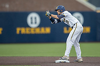 Michigan Wolverines first baseman Jake Bivens (18) celebrates hitting a double against the Michigan State Spartans on May 19, 2017 at Ray Fisher Stadium in Ann Arbor, Michigan. Michigan defeated Michigan State 11-6. (Andrew Woolley/Four Seam Images)