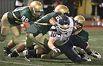 Jesuit defenders prevent Lake Oswego's Will Storey from converting two points after Storey scored a game-winner making the score 32-28  over the Crudaders in the semifinal at PGE Park November 28, 2008.
