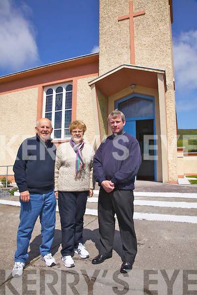 Marilyn Stawski the great great grand niece of Julia & Johanna O'Sullivan from the Glen, who's generous donation in 1952 funded the building of the Church of the Sacred Heart in St Finnians Bay pictured here with her husband Frank and Fr Gunn outside the Church...Ref Breda Joy