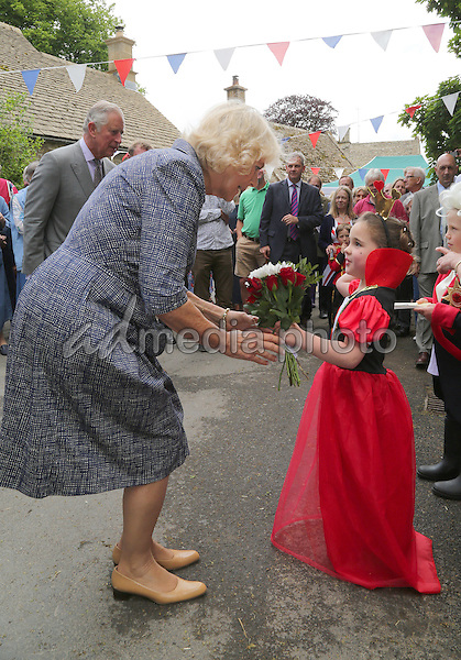 12 June 2016 - Prince Charles Prince of Wales and Camilla Duchess of Cornwall recieves a posey from the winner of the fancy dress competition, Ellie-Mai Pullin at a street party in Brimpsfield, Gloucestershire, as part of the three day celebrations for Queen Elizabeth II's official 90th birthday. The Big Lunch is an annual event started by the Eden Project which aims to get as many people as possible to have lunch together, in their neighbourhoods, in order to encourage more of a community spirit throughout the Nation. Photo Credit: ALPR/AdMedia