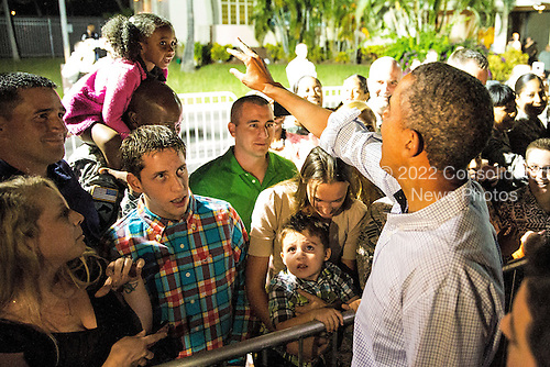 United States President Barack Obama greets well-wishers before boarding Air Force One on January 4, 2014 at Joint Base Pearl Harbor-Hickam in Honolulu, Hawaii. The President and daughters Sasha and Malia are returning to Washington, DC from Hawaii where they spent the winter holiday, while the First Lady is remaining in Hawaii. <br /> Credit: Kent Nishimura / Pool via CNP