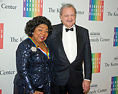 2013 Kennedy Center honoree Martina Arroyo and Paolo Petrini arrive for the formal Artist's Dinner honoring the recipients of the 2014 Kennedy Center Honors hosted by United States Secretary of State John F. Kerry at the U.S. Department of State in Washington, D.C. on Saturday, December 6, 2014. The 2014 honorees are: singer Al Green, actor and filmmaker Tom Hanks, ballerina Patricia McBride, singer-songwriter Sting, and comedienne Lily Tomlin.<br /> Credit: Ron Sachs / Pool via CNP