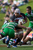 Fritz Lee looks to fend off the tackle of Turbos captain & No 7 Josh Bradnock. Air New Zealand Cup rugby game between the Counties Manukau Steelers & Manawatu Turbos, played at Growers Stadium Pukekohe on Staurday September 20th 2008..Counties Manukau won 27 - 14 after trailing 14 - 7 at halftime.