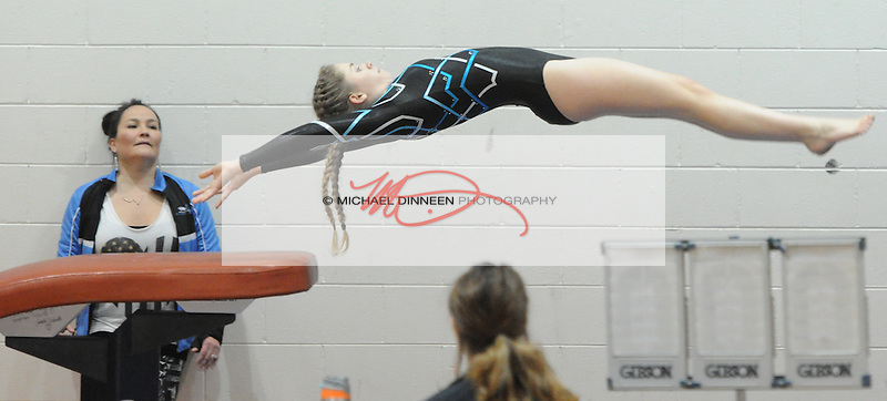 Chugiak High gymnastics coach Wendy Wiltfong watches team member Kiya Gates perform on the vault during a meet with Service, South and Dimond Friday, Oct. 21, 2016.  Photo for the Star by Michael Dinneen