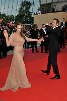 ANGELINA JOLIE &amp; BRAD PITT<br /> The &quot;Inglourious Basterds&quot; Premiere at the Grand Theatre Lumiere during the 62nd Annual Cannes Film Festival, Cannes, France.<br /> May 20th, 2009<br /> full length black tuxedo suit cream beige brown pink dress sheer long couple  back behind rear hand holding waving palm <br /> CAP/PL<br /> &copy;Phil Loftus/Capital Pictures /MediaPunch ***NORTH AND SOUTH AMERICAS ONLY***
