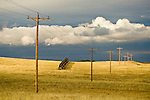 Power lines and snow drift fence, afternoon thunderstorm over the Thunder Basin National Grassland, Wyoming.