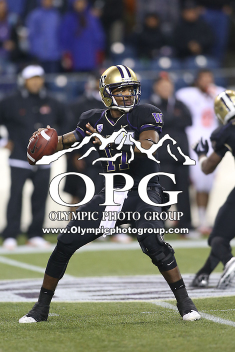 OCT 27, 2012: Washington' quarterback #17 Keith Price looks down field for an open receiver against Oregon State.  Washington won 20-17 over Oregon State at CenturyLink Field in Seattle, WA...