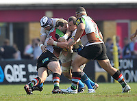 London, England. Dave Attwood of Bath Rugby tackles Joe Marler of Harlequins during the Aviva Premiership match between Harlequins and Bath Rugby at Twickenham Stoop on March 24, 2012 in Twickenham, England.