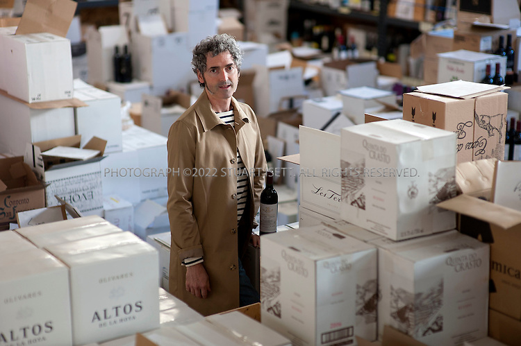 10/6/2010--Seattle, WA, USA..Jon Rimmerman, 43, of Garagiste, in his warehouse filled with boxes of wine ready to be shipped from  Seattle's Sodo district...©2010 Stuart Isett. All rights reserved.