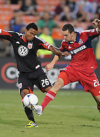 D.C. United forward Lionard Pajoy (26) goes against Chicago Fire defender Austin Berry (22) D.C. United defeated The Chicago Fire 4-2 at RFK Stadium, Wednesday August 22, 2012.