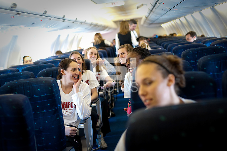 SAN JOSE, CA - MARCH 31, 2011: The Stanford Women's Basketball team shares a laugh before takeoff en route to the NCAA Final Four at the San Jose International Airport on March 31, 2011.