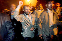 Iranian President Mahmoud Ahmadinejad waves to supporters in the Imam Sadegh University in Tehran, one of the strongest bastions of support for the controversial leader.