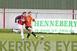 Annascaul FC's Paul Whelan gets away from Kilflynn Santos Gary Whelan at Mounthawk park, Tralee on Sunday.