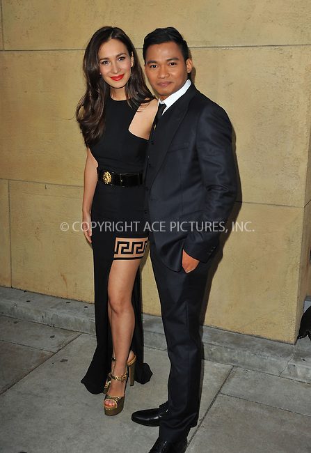 WWW.ACEPIXS.COM<br /> <br /> May 6 2015, LA<br /> <br /> Celina Jade, Tony Jaa arriving at the premiere Of 'Skin Trade'  at the Egyptian Theatre on May 6, 2015 in Hollywood, California.<br /> <br /> <br /> By Line: Peter West/ACE Pictures<br /> <br /> <br /> ACE Pictures, Inc.<br /> tel: 646 769 0430<br /> Email: info@acepixs.com<br /> www.acepixs.com