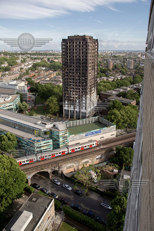 The charred remains of Grenfell Tower in North Kensington where a devastating fire that swept up the 24 storey building in the early hours of Wednesday, 14th June killing at least 79 people and leaving many more without homes or possessions.