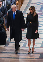 December 5, 2018 - Washington, DC, United States: United States President Donald J. Trump and First Lady Melania Trump attend the state funeral service of former President George W. Bush at the National Cathedral.  <br /> <br /> CAP/MPI/RS<br /> &copy;RS/MPI/Capital Pictures