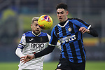 Alessandro Bastoni of Inter and Alejandro Gomez of Atalanta race after the ball during the Serie A match at Giuseppe Meazza, Milan. Picture date: 11th January 2020. Picture credit should read: Jonathan Moscrop/Sportimage
