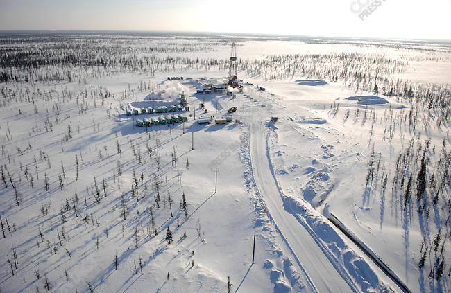 A drilling rig, boring holes for gas production, stood in the snowy forest of the Yuzhno-Russkoye natural gas field, one of Gazprom's newest fields, supplying gas headed to Europe, Yamal-Nenets Autonomous District, Russia, February 27, 2008